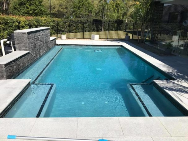Backyard Swimming Pool With Water Feature